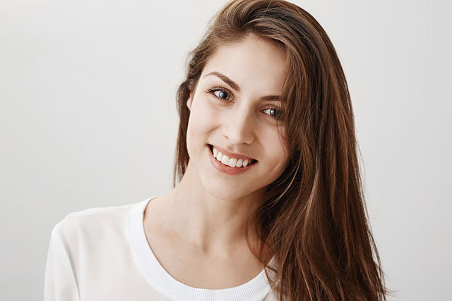 A young woman smiling